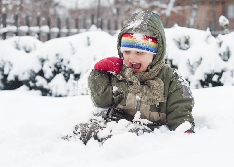Download Child Playing In Snow Stock Photography - Image: 25223322