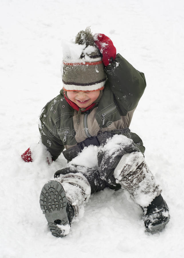 Child playing in snow