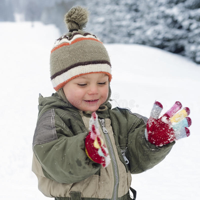 Child playing with snow stock photos