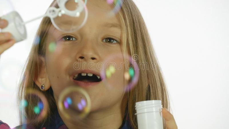 Child Playing Soap Bubbles, Happy Smiling Girl Blowing Balloons, Slow Motion stock images