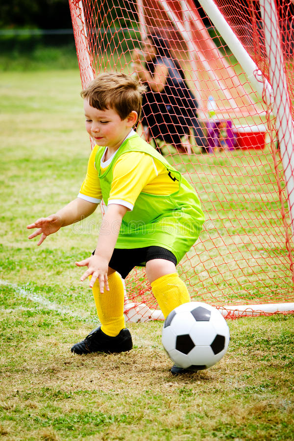 Child playing soccer goalie. Young child boy playing soccer goalie during organized league game royalty free stock photo