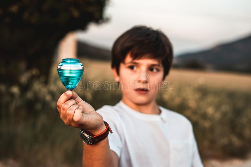 Child playing spinning top. Concept of happy playing children. Kid playing spinning top.Concept of happy playing children royalty free stock photos
