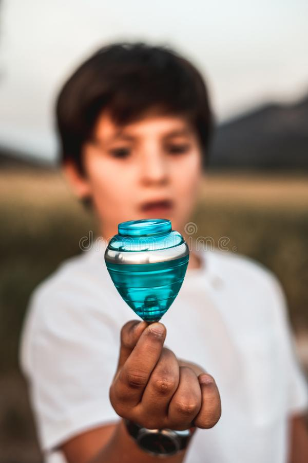 Child playing spinning top. Concept of happy playing children. Kid playing spinning top.Concept of happy playing children royalty free stock photography