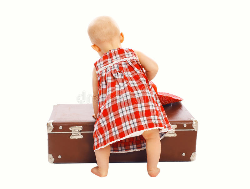 Child playing with the suitcase stock photos
