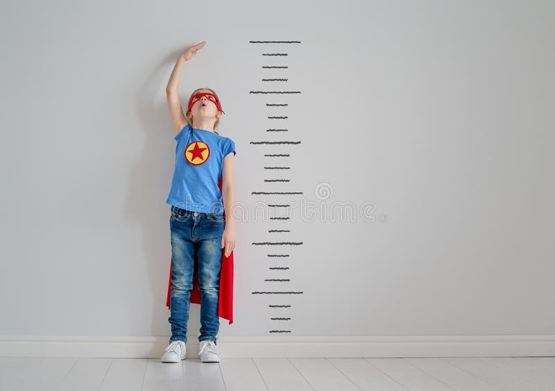 Child is playing superhero royalty free stock photography