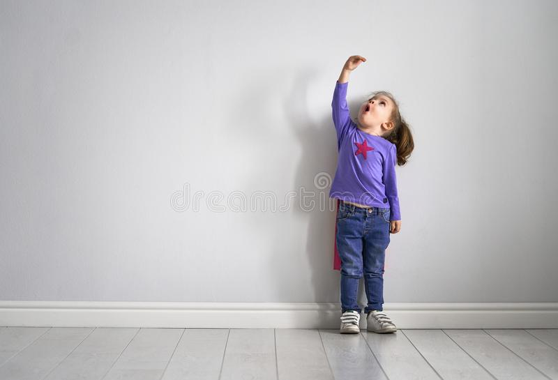 Child is playing superhero royalty free stock photo