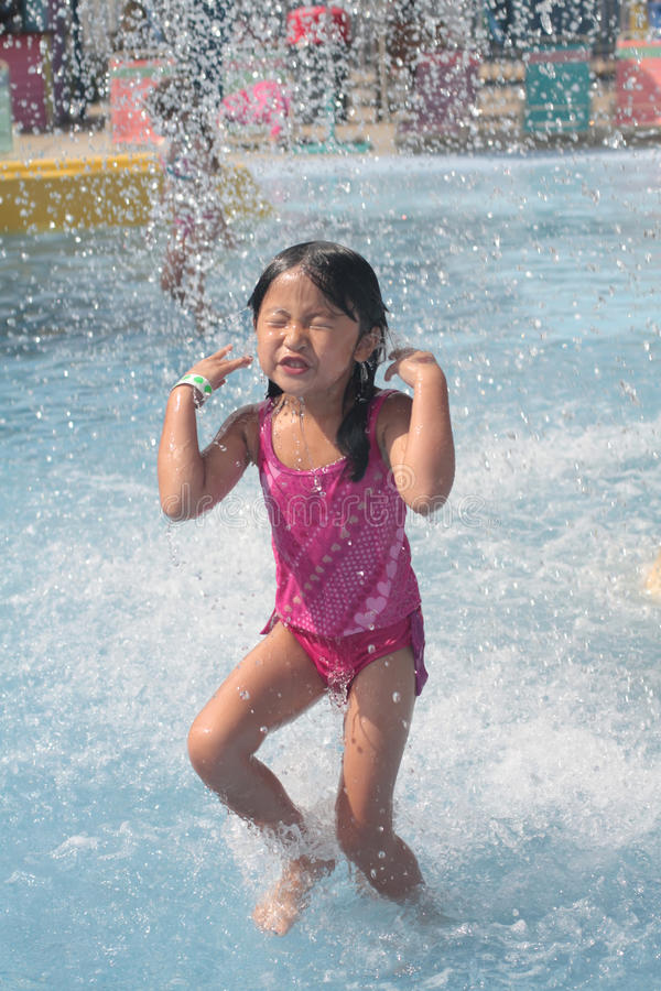 Child playing in swimming pool royalty free stock photos