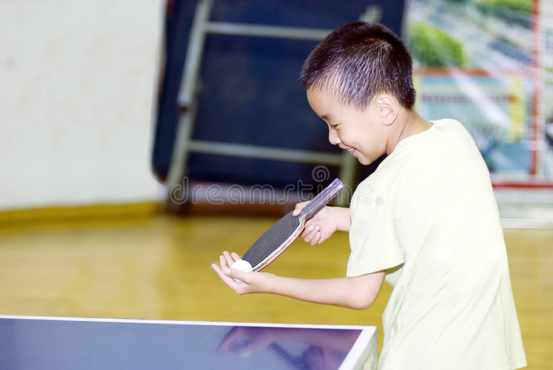A child playing table tennis royalty free stock photo