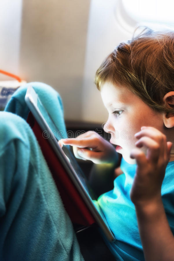 Child playing with tablet stock images