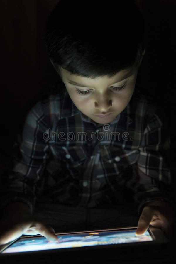 Child playing with a tablet pc stock photo