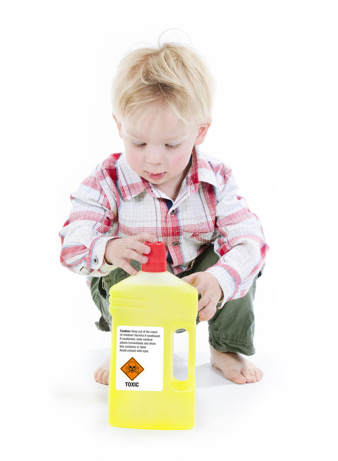 Child playing with toxic cleaner. Materials no adults supervision royalty free stock photography
