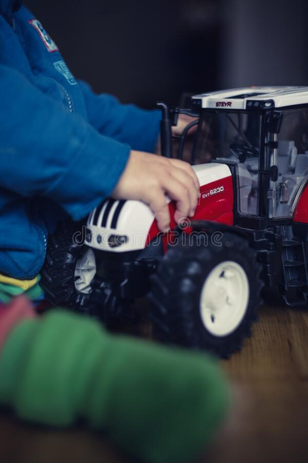 Child playing with toy tractor stock images