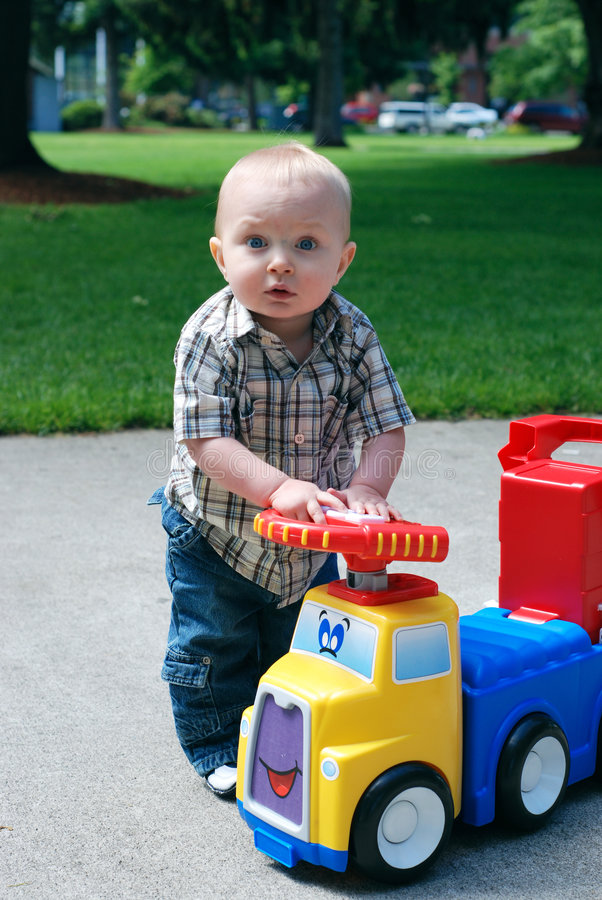 Download Child Playing With Toy Truck - Vertical Stock Images - Image: 5559984