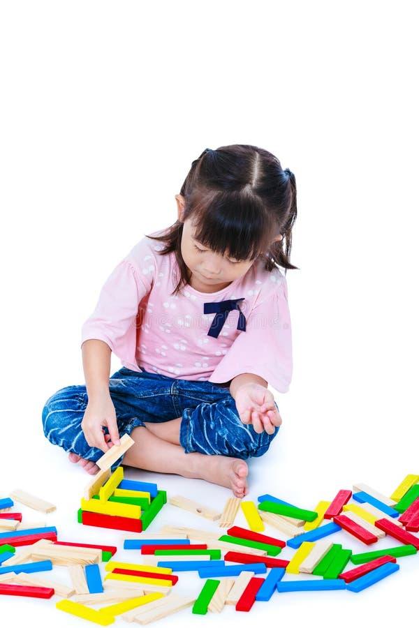 Child playing toy wood blocks, isolated on white background. stock image
