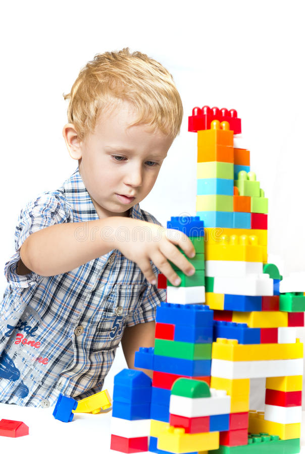 Download Child playing with toys stock photo. Image of action - 26773746