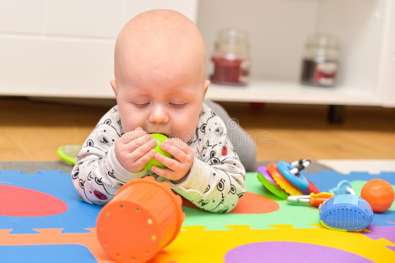 Child Playing Toys. Children Development Concept. Baby Kid. Adorable toddler boy playing with toys at home or daycare place royalty free stock images