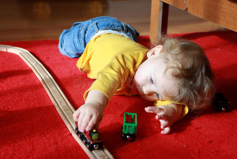 Download Child Playing With Trains At Home Stock Photo - Image of toddler, small: 29039596