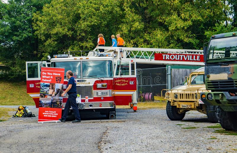 Child Playing on a Troutville Firetruck. Botetourt County, VA – September 21th: Children enjoying playing on a Troutville firetruck at the 50th Annual stock image
