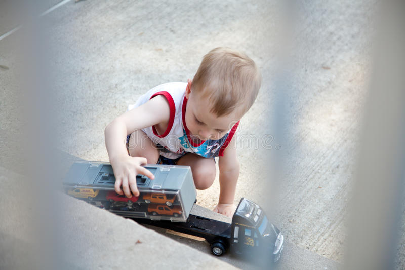 Download Child playing with truck stock photo. Image of learning - 14858120