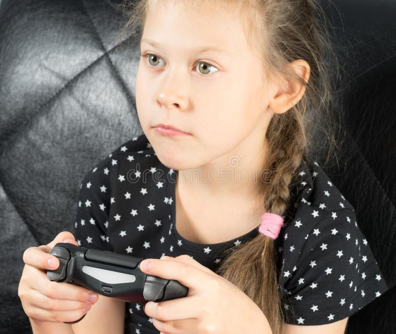 Child playing video games royalty free stock photography