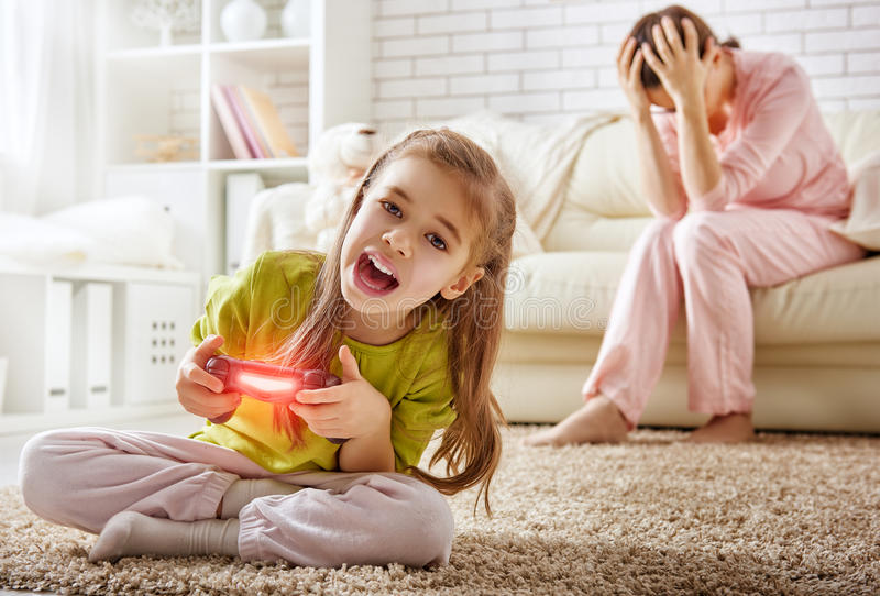 Child playing video games stock image