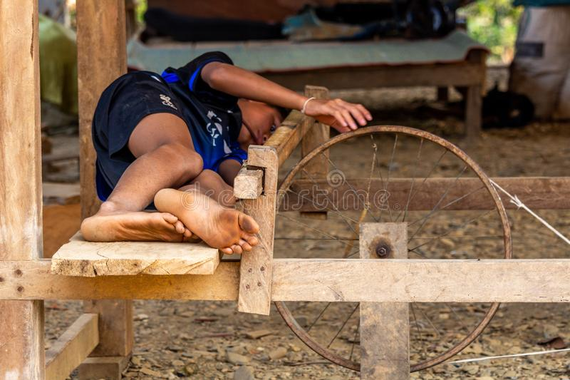 Child playing with a wheel Laos royalty free stock photography