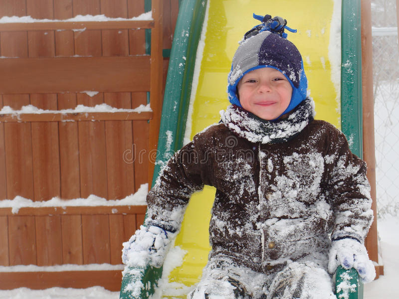 Download Child Playing In Winter Snow Stock Image - Image: 40713393