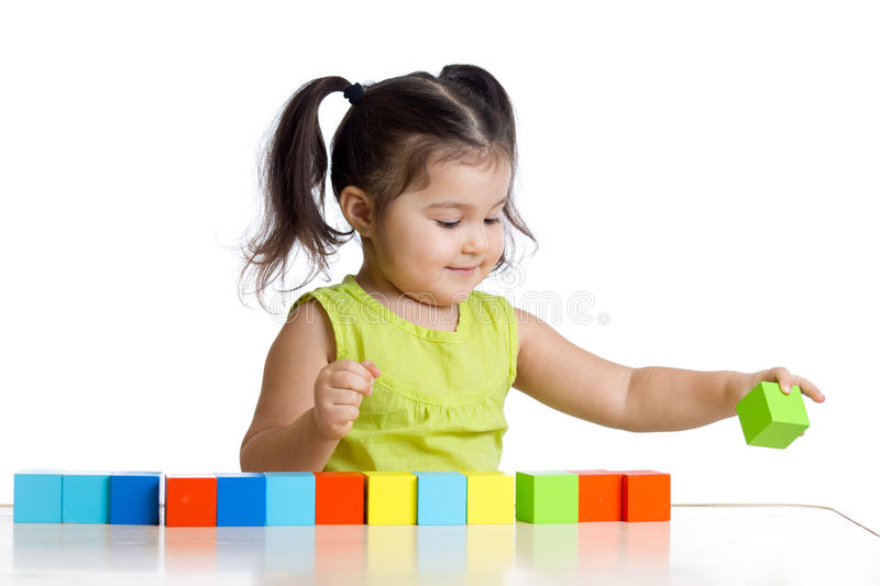Child plays with building blocks and learning of stock photography