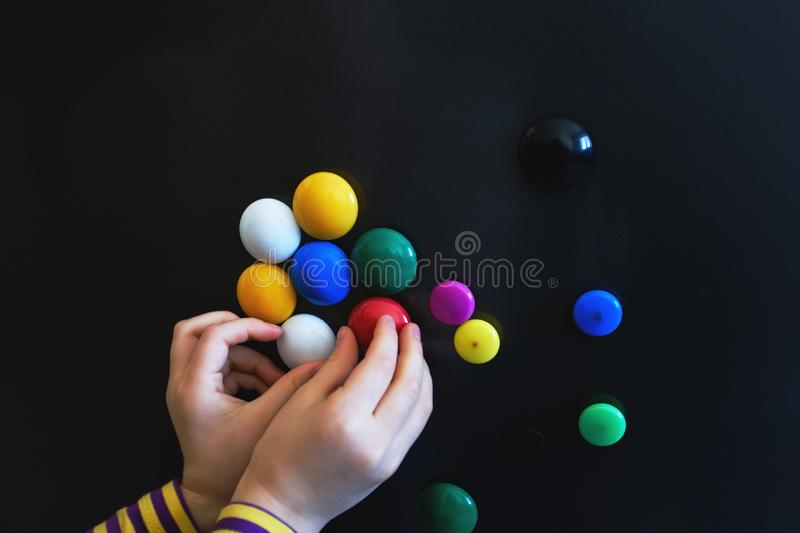 The child plays with colored magnets, close-up stock images