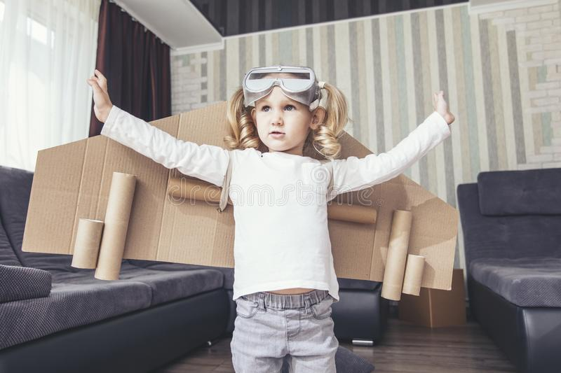 Child plays in the costume of the pilot and wants to fly in the royalty free stock images