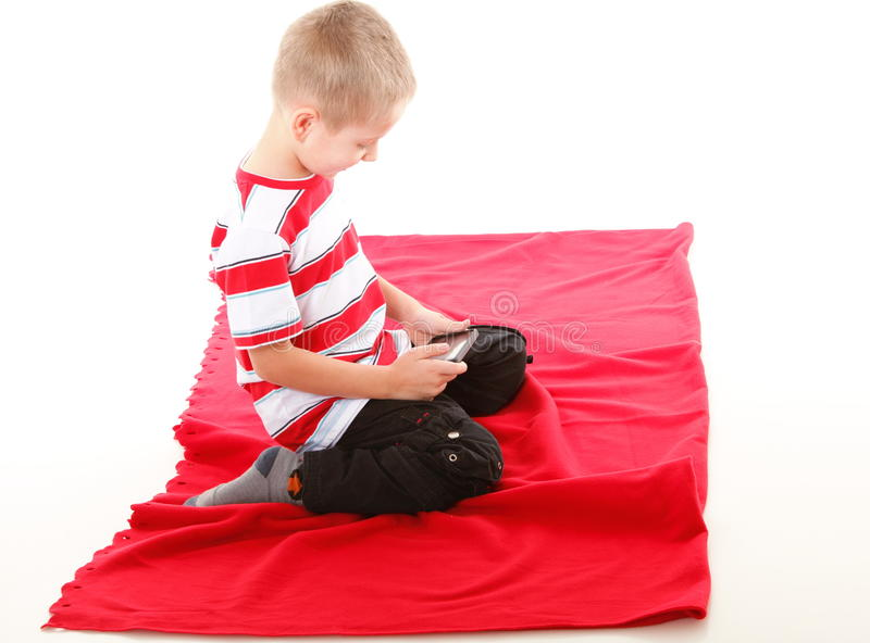 Download Child Plays Games On The Mobile Phone Stock Photo - Image: 33095378