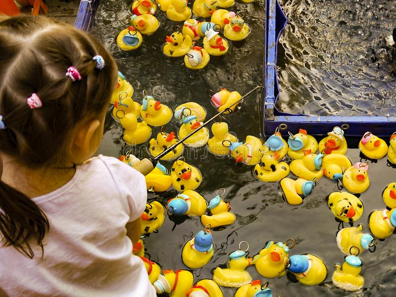 A child plays a homemade duck hunt game. royalty free stock photos