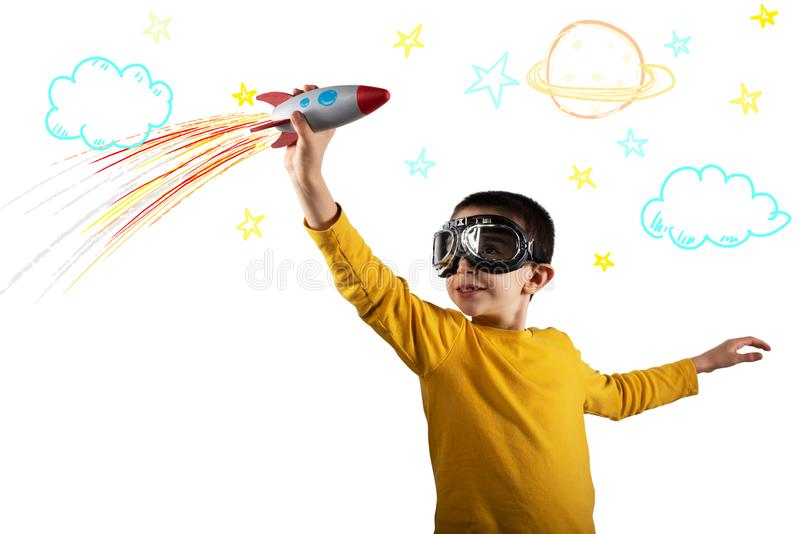 Child plays with a rocket. Concept of imagination. Isolated on white background royalty free stock photo