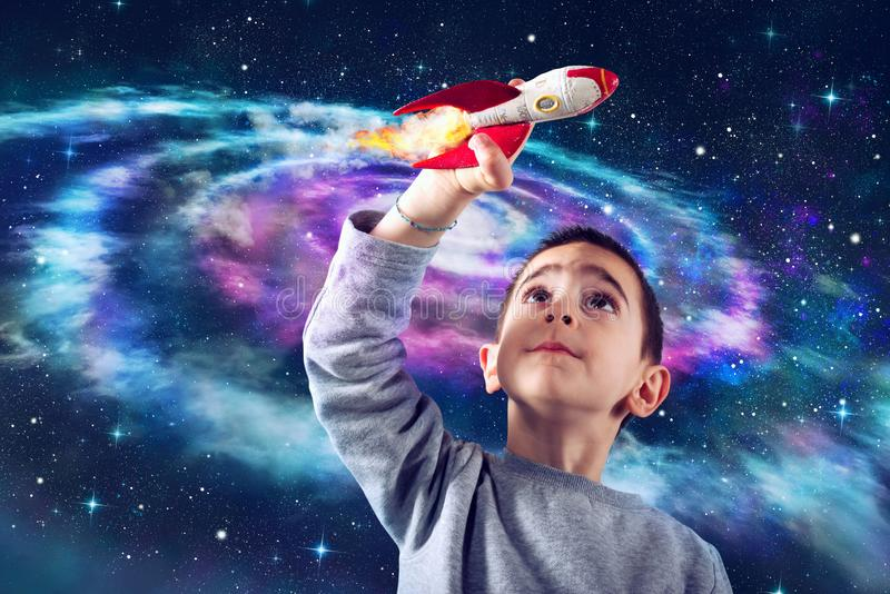 Child plays with a rocket. Concept of imagination royalty free stock photo