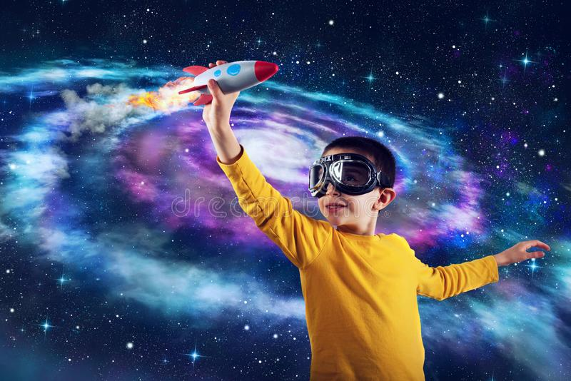 Child plays with a rocket. Concept of imagination stock photos