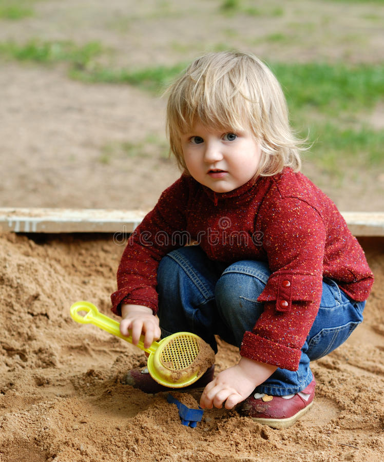 Child plays with sand royalty free stock photos