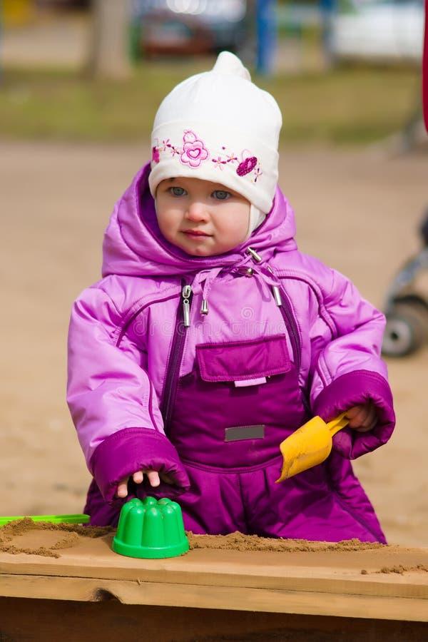 Child plays in sandbox