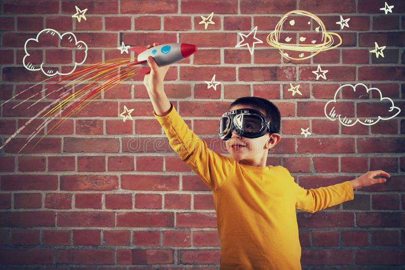 Child plays with a rocket. Concept of imagination royalty free stock photography
