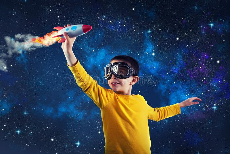 Child plays with a rocket. Concept of imagination royalty free stock photos