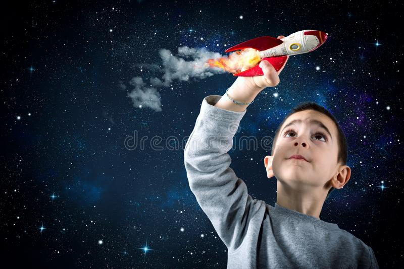 Child plays with a rocket. Concept of imagination royalty free stock images