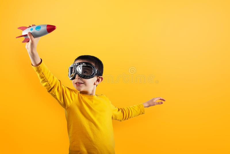 Child plays with a rocket. Concept of imagination. stock photography