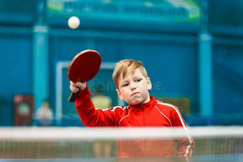 Child plays table tennis in the gym stock images
