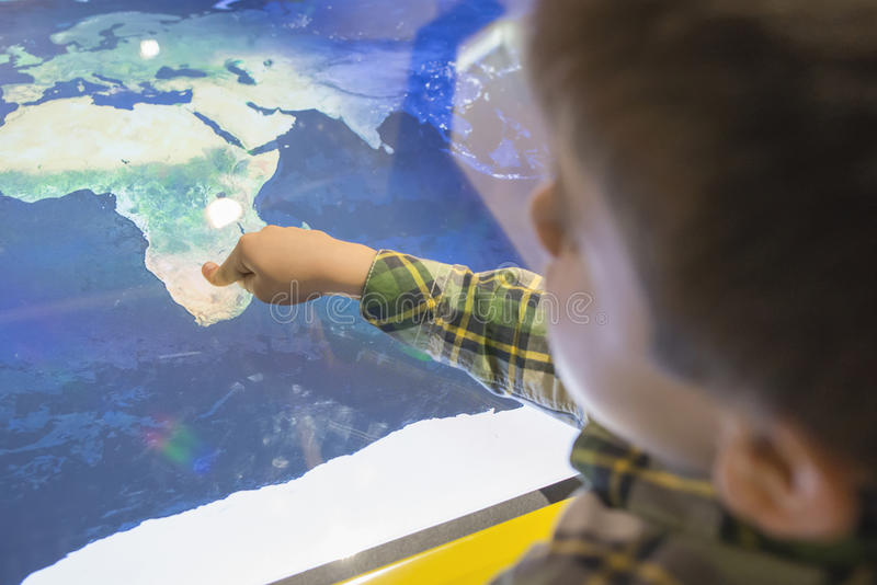 Child pointing Africa on a map royalty free stock photo