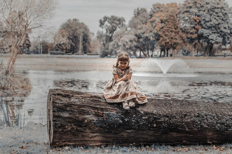 A child at the pond stock photography