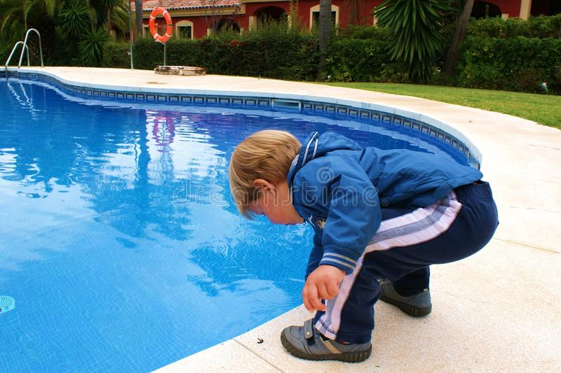 The child at the pool. The small child one at the pool stock photography