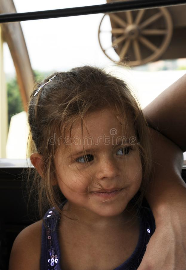 Child portrait of cute blonde little girl with disheveled messy hair.  stock image