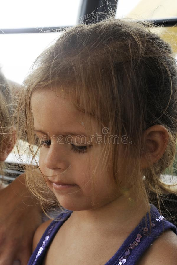 Child portrait of cute blonde little girl with disheveled messy hair. Sadness concept.  stock images