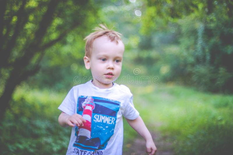 Child portrait outdoors. Happy boy royalty free stock images