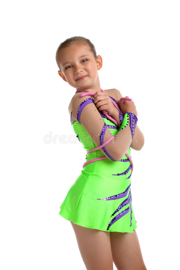 Child posing in green - young gymnast isolated stock photos