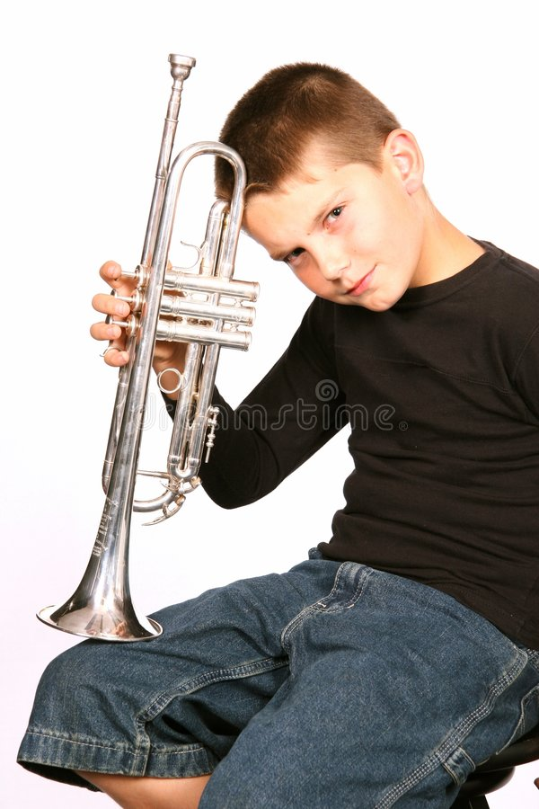 Child Posing With Trumpet royalty free stock images